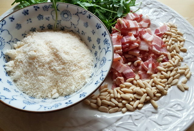baked passatelli with pancetta and pine nuts