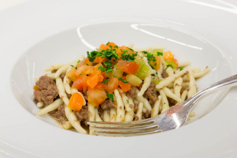 Strozzapreti with meat sauce and vegetables