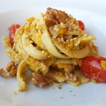 Scialatielli pasta with yellow peppers, tomatoes & walnuts
