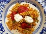 Fusilli pasta with tomatoes, basil & burrata cream.