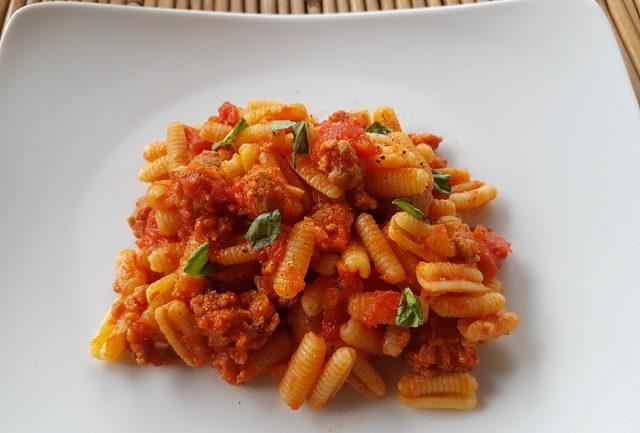 malloreddus gnocchi with sausage, tomatoes and saffron