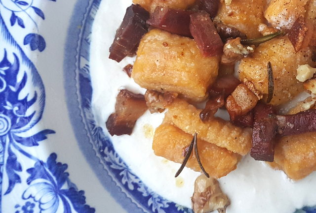 Pumpkin gnocchi with speck and walnuts