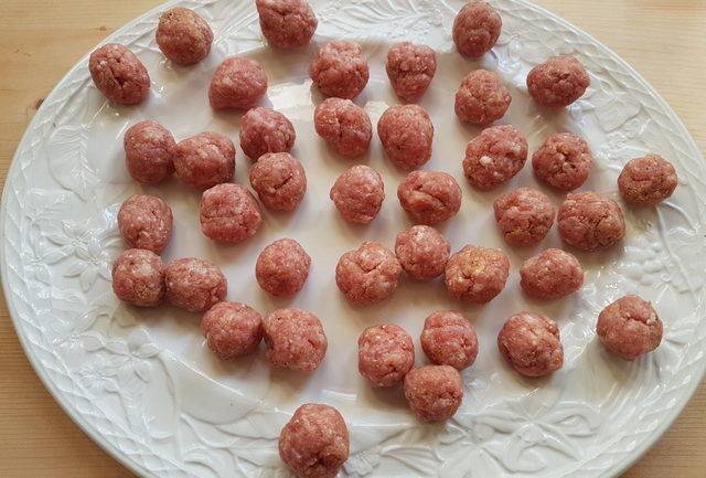 small veal meatballs on white plate