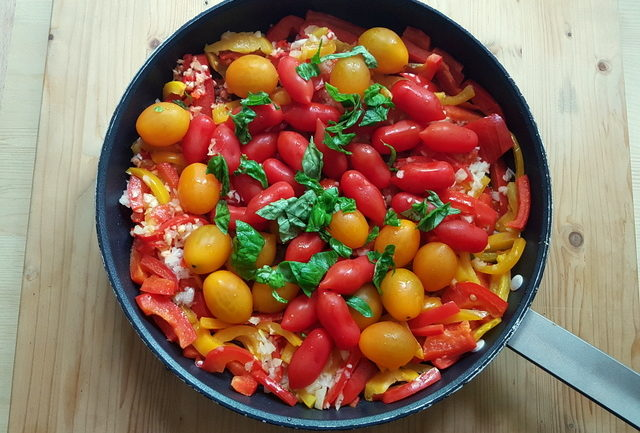 ingredients for bucatini with red and yellow cherry tomatoes and peppers recipe in frying pan