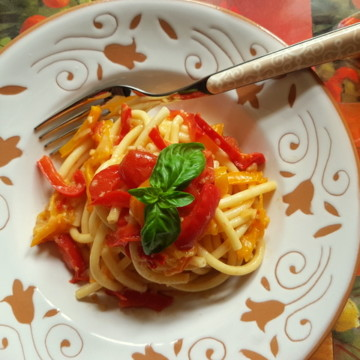 Bucatini with red and yellow cherry tomatoes and peppers