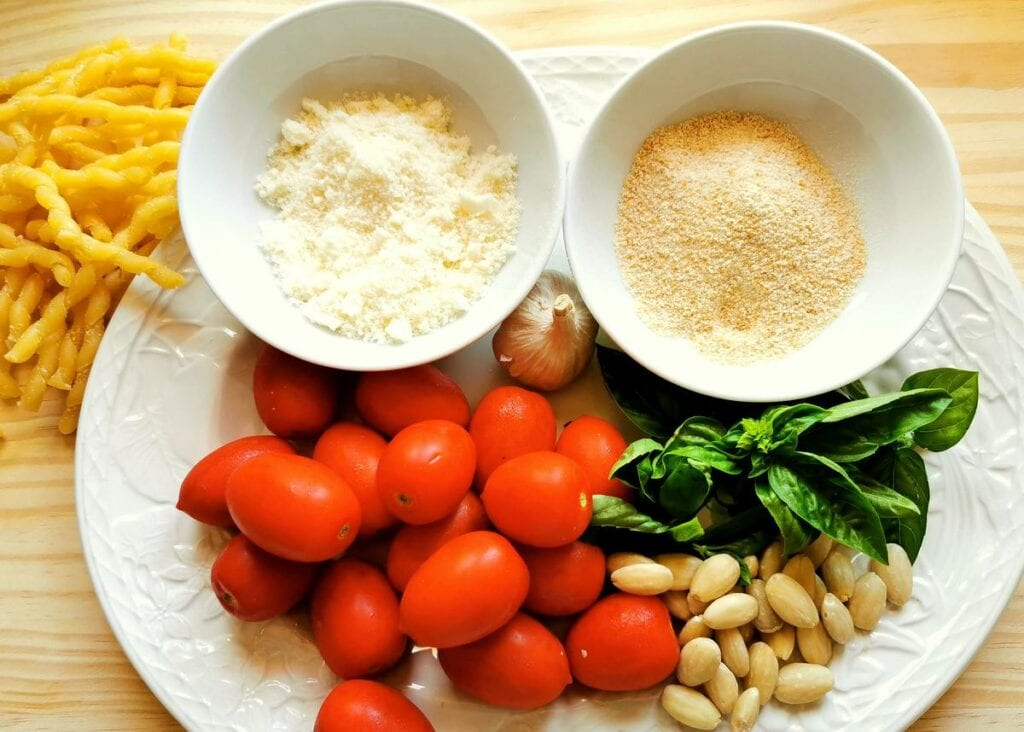 ingredients for Trapanese pesto on white plate
