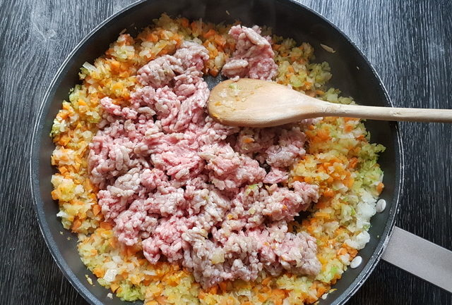 minced veal, carrots, onions and celery in frying pan