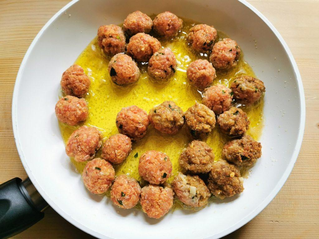 meatballs cooking in frying pan
