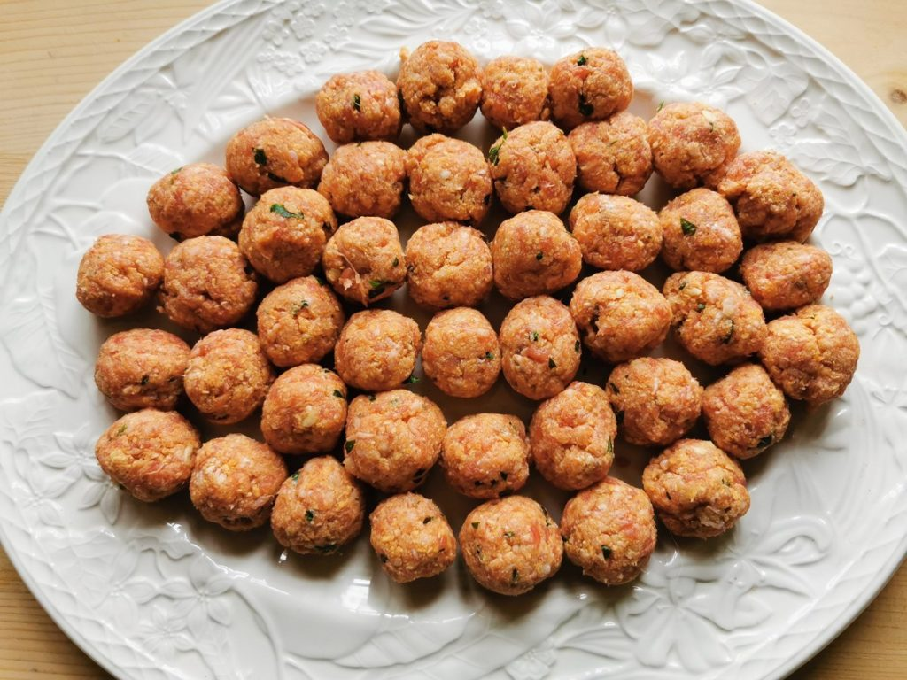 ready rolled meatballs on white plate