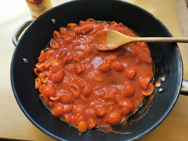 tomato sauce made with cherry tomatoes and passata in skillet
