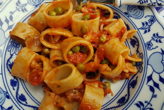 Calamarata pasta with stewed cuttlefish and peas