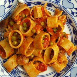 Calamarata pasta with stewed cuttlefish and peas