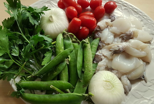 ingredients for calamarata pasta with stewed cuttlefish and peas