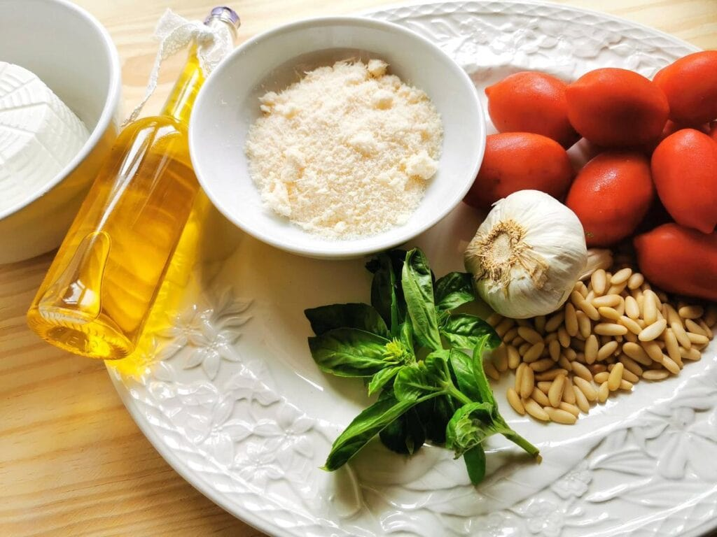 ingredients for Sicilian pesto on white plate