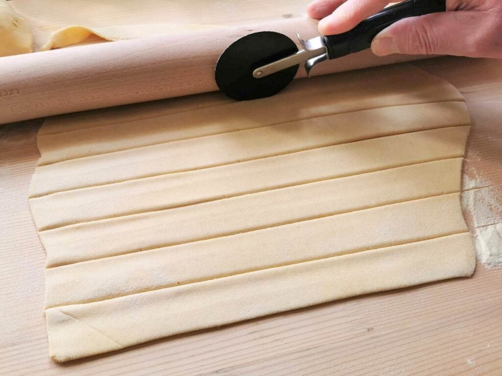 rolled out dough cut into strips