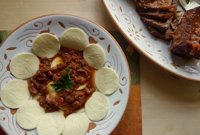 Corzetti pasta with Genovese meat sauce