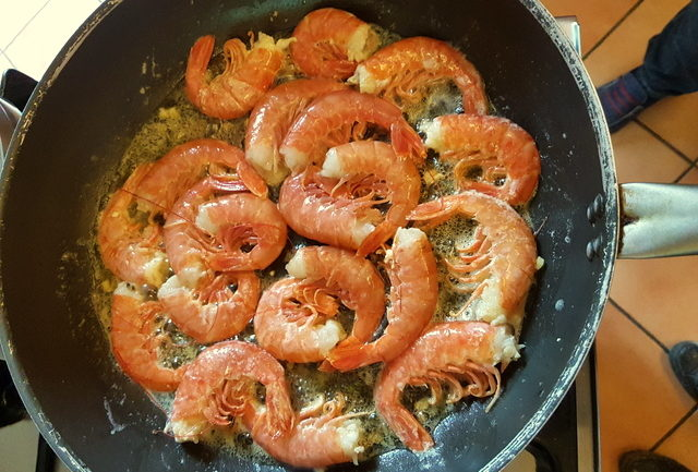 Prawns cooking in frying pan for fettuccine pasta with giant prawns