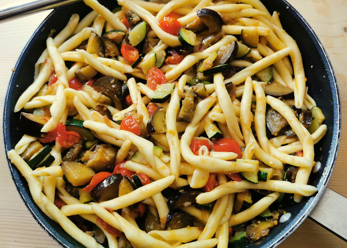 cooked fileja pasta added to sauce in skillet