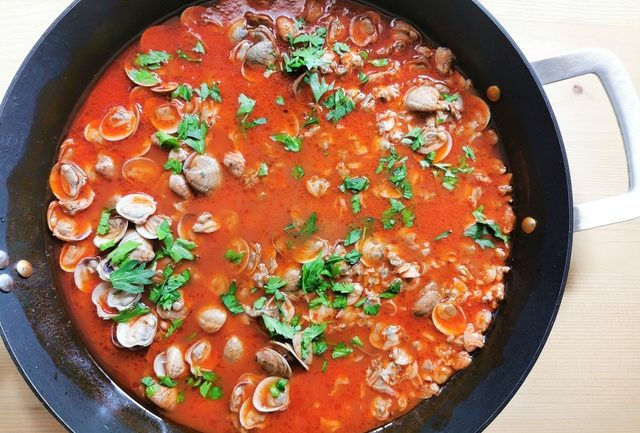 clam and tomato sauce cooking in skillet