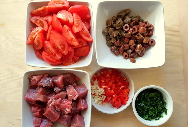 ingredients fo fresh tuna pasta all'eoliana chopped in white bowls