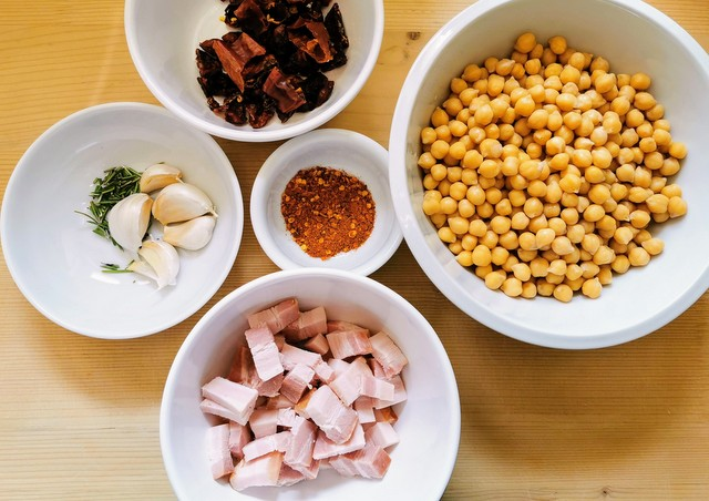 chickpea broth ingredients chopped and prepared in white bowls