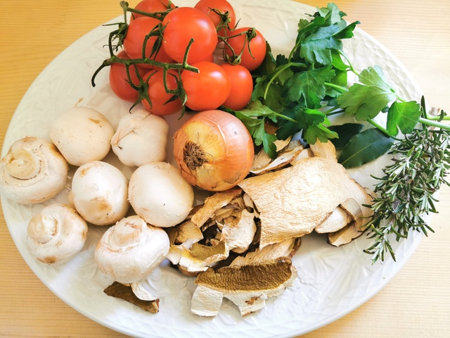 ingredients for Genovese mushroom ragu on white plate