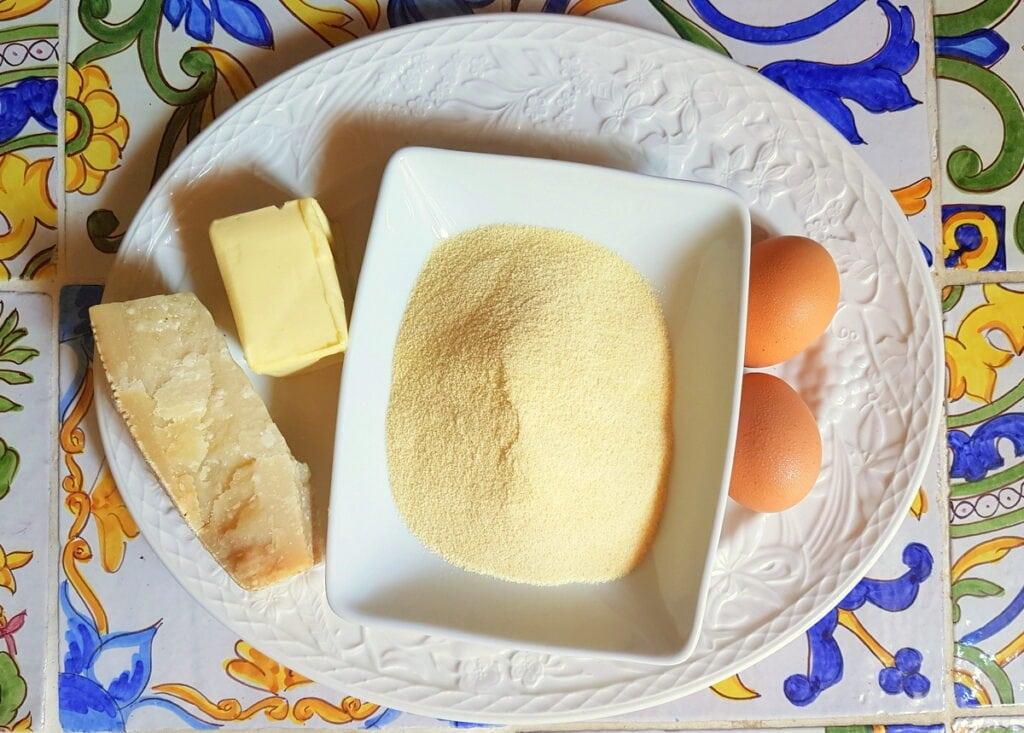 ingredients for gnocchi alla Romana on white plate