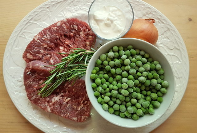 ingredients for gramigna with sausage, peas and cream.