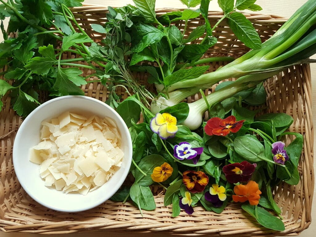 ingredients for green pasta salad in woven basket