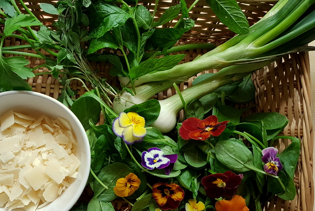 Ingredients in basket for green pasta salad with edible flowers