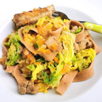 homemade chestnut pasta with pork and cabbage