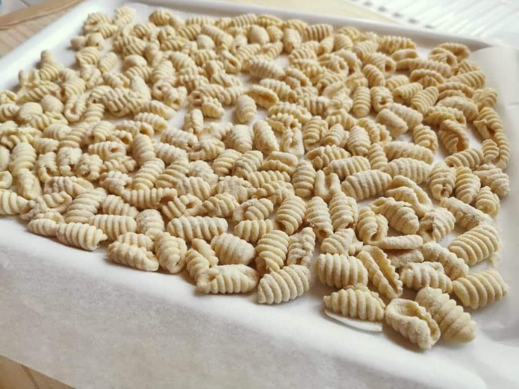 Ready homemade Sardinian gnocchi on tray