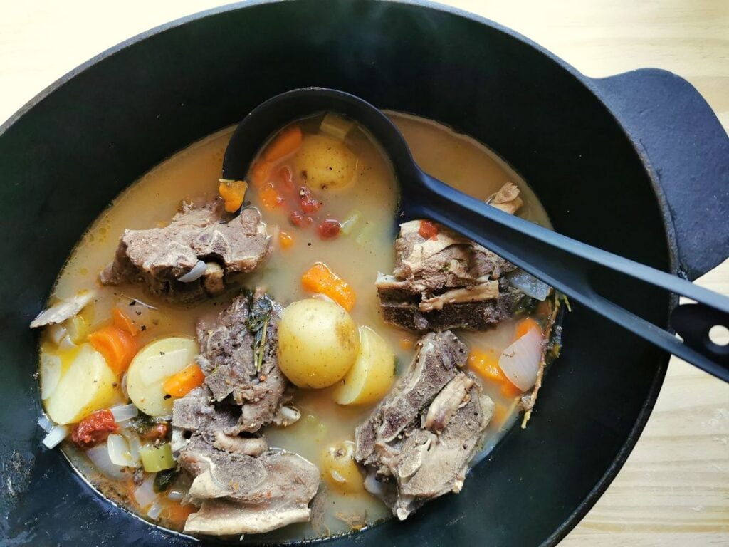 potatoes added to lamb broth in Dutch oven
