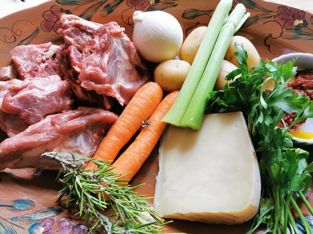 Ingredients for lamb broth on terracotta dish