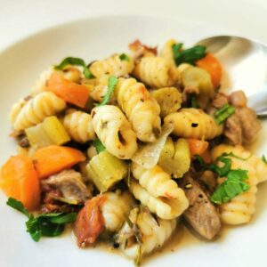 Homemade Sardinian gnocchi (malloreddus) cooked in lamb broth.