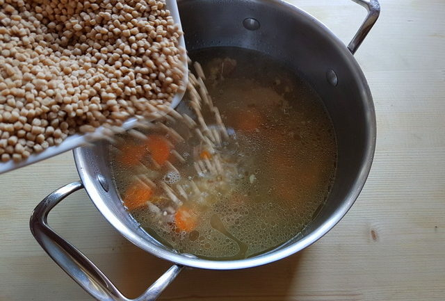 Homemade beef broth with whole-wheat grattoni pasta.