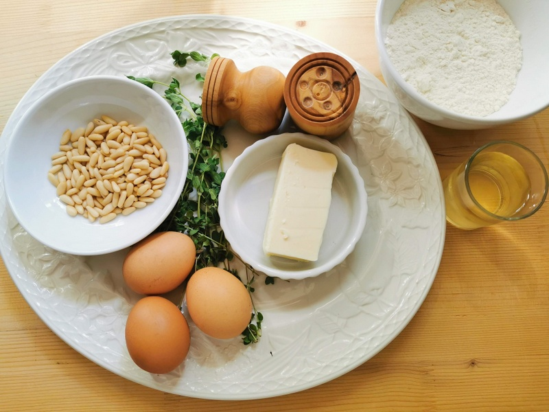 ingredients for homemade corzetti pasta with marjoram and pine nuts