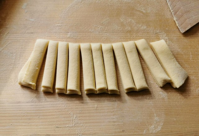 homemade sagne pasta strips on wooden board