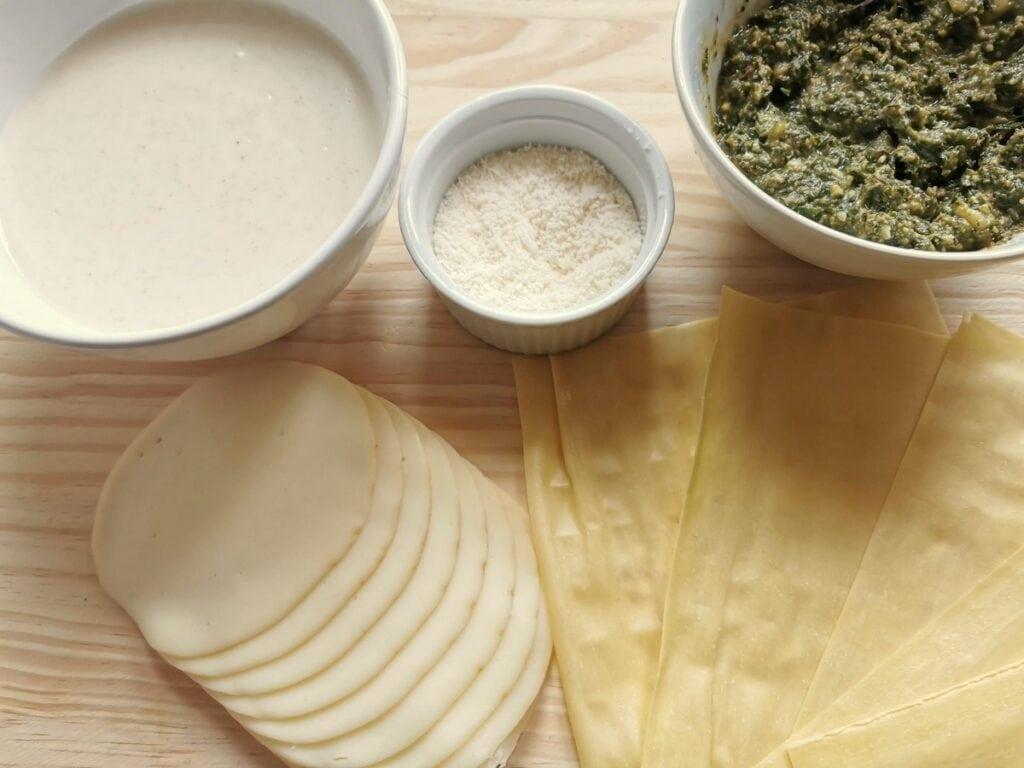 ingredients for pesto lasagna on wooden board