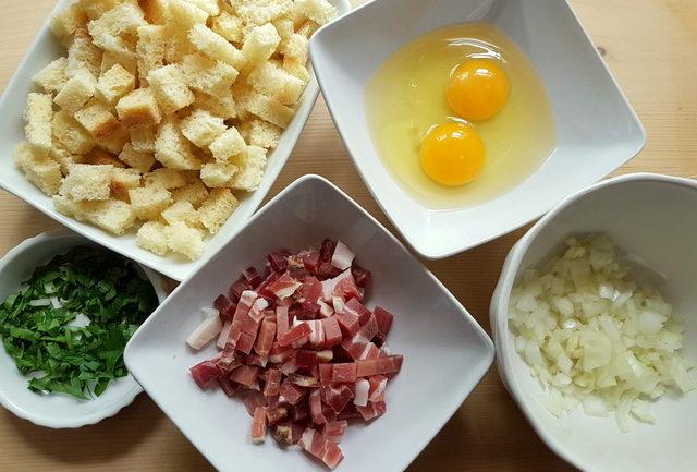 prepared ingredients for Italian dumplings in white bowls