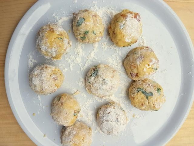 ready to cook Italian dumplings (canederli) on white plate