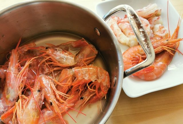 prawn heads and shells in saucepan with water