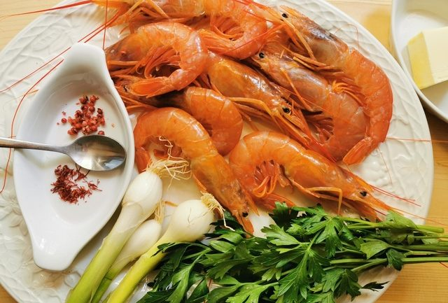 ingredients for prawn saffron linguine sauce on white plate