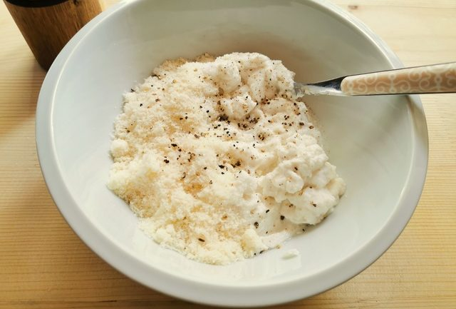 ricotta and grated parmigiano in white bowl