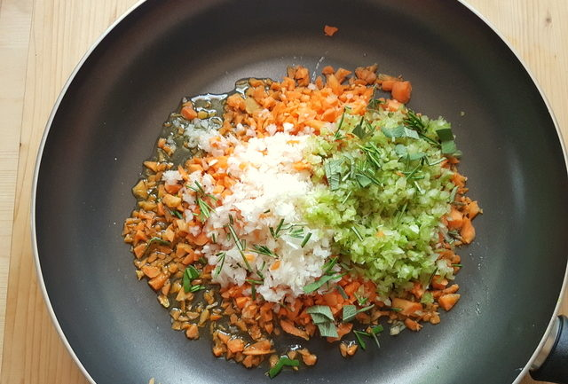 chopped onions, carrots and celery in frying pan