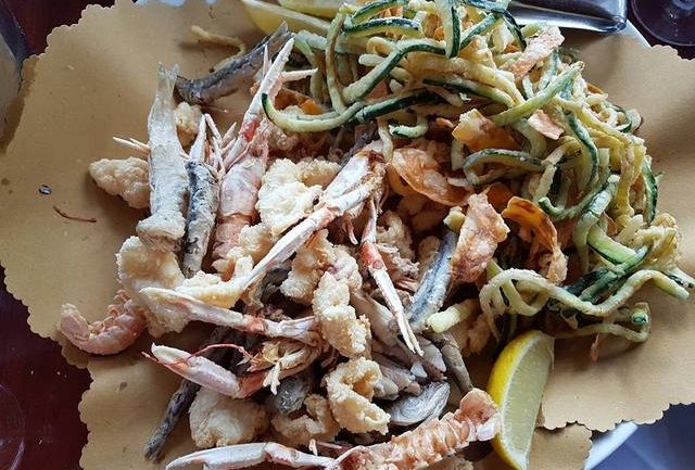 deep fried seafood in restaurant in Le Marche region