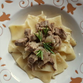 Maltagliati pasta with braised veal and onions