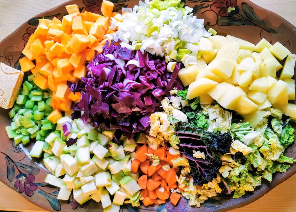 cleaned, chopped and sliced vegetables for minestrone on oval plate