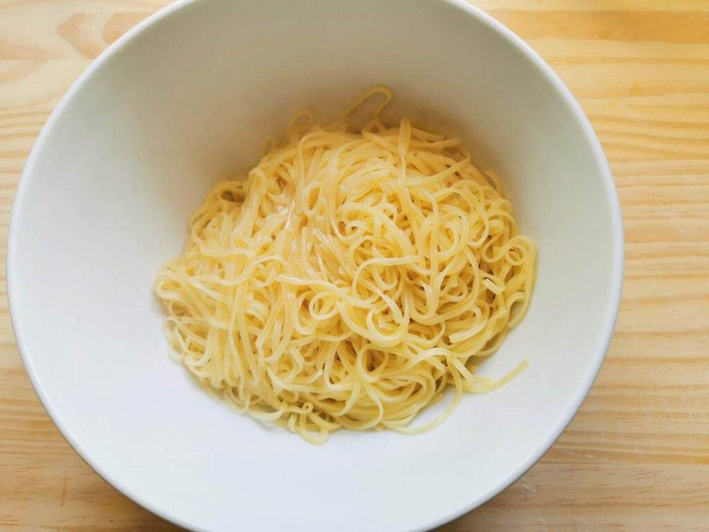 cooked tagliolini in white bowl
