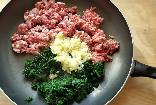 sausage meat, ground veal, cooked spinach and cooked onions in frying pan